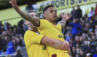 Burnley's Andre Gray, right, celebrates with teammate Sam Vokes after scoring his side's second goal during their English Premier League match against Crystal Palace at Selhurst Park, London, Saturday, April 29, 2017. (Nigel French/PA via AP)