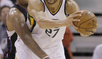 Los Angeles Clippers center Marreese Speights, left, defends Utah Jazz center Rudy Gobert during the first half in Game 6 of an NBA basketball first-round playoff series Friday, April 28, 2017, in Salt Lake City. (AP Photo/Rick Bowmer)
