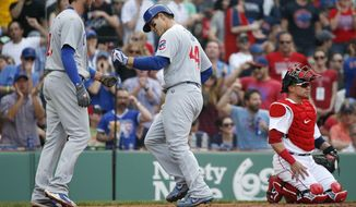 Chicago Cubs' Anthony Rizzo (44) celebrates his two-run home run that also drove in Kris Bryant, left, behind Boston Red Sox's Christian Vazquez, right, during the fourth inning of a baseball game, Saturday, April 29, 2017, in Boston. (AP Photo/Michael Dwyer)