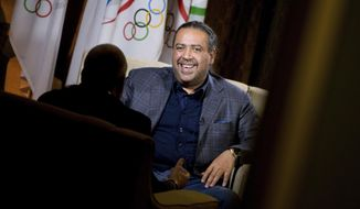 FILE- In this Monday, Oct. 26, 2015 file photo, Asian Olympic leader Kuwaiti Sheik Ahmad Al-Fahad Al-Sabah speaks during an interview with the Associated Press at the Washington Hilton, in Washington. Ahmad denies claims in a U.S. federal court that he bribed FIFA voters.(AP Photo/Andrew Harnik, File)