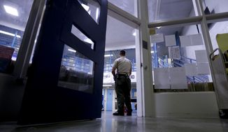 A Sheriff officer stands guard over inmates at the Twin Towers Correctional Facility Thursday, April 27, 2017, in Los Angeles. One of the world's largest jail complexes is located in Los Angeles and within it resides perhaps the world's largest group of inmates whose mental illness is attributed to drug abuse, mainly from highly addictive methamphetamine. (AP Photo/Chris Carlson)