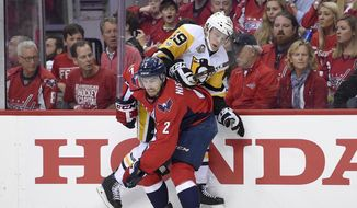 Pittsburgh Penguins center Jake Guentzel (59) tries to get past Washington Capitals defenseman Matt Niskanen (2) during the first period of Game 2 in an NHL hockey Stanley Cup second-round playoff series, Saturday, April 29, 2017, in Washington. (AP Photo/Nick Wass)