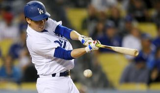 Los Angeles Dodgers' Kenta Maeda swings at a pitch during the third inning of a baseball game against the Philadelphia Phillies, Friday, April 28, 2017, in Los Angeles. (AP Photo/Mark J. Terrill)