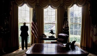 In this photo taken April 21, 2017, President Donald Trump looks out an Oval Office window at the White House in Washington following an interview with The Associated Press. Health care is complicated. China can be a useful ally. NATO is not obsolete. Being president is hard.Over the course of his 100 days in office, President Donald Trump has been startlingly candid about his public education in the ways of Washington and the world. (AP Photo/Andrew Harnik)