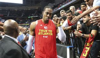 Atlanta Hawks Dwight Howard, who did not play in the fourth quarter, leaves the court after his team fell to the Washington Wizards in Game 6 of a first-round NBA basketball playoff series on Friday, April 28, 2017, in Atlanta. (Curtis Compton/Atlanta Journal-Constitution via AP)