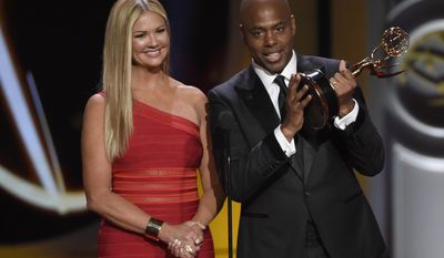 "Nancy O'Dell, left, and Kevin Frazier accept the award for outstanding entertainment news program for ""Entertainment Tonight"" at the 44th annual Daytime Emmy Awards at the Pasadena Civic Center on Sunday, April 30, 2017, in Pasadena, Calif. (Photo by Chris Pizzello/Invision/AP)"