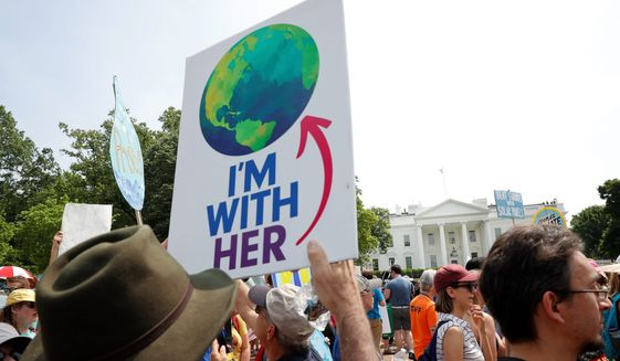 Thousands of people demonstrate against President Trump's environmental policies as he considers whether to leave the Paris climate accord. (Associated Press/File)