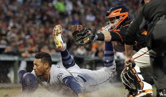 San Diego Padres' Yangervis Solarte, left, is tagged out by San Francisco Giants catcher Buster Posey in the sixth inning of a baseball game Saturday, April 29, 2017, in San Francisco. Solarte was attempting to score on a double by Padres' Hunter Renfroe. (AP Photo/Ben Margot)
