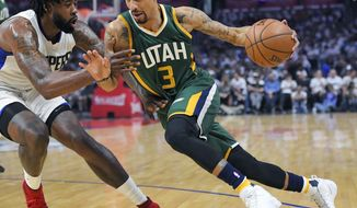 Utah Jazz guard George Hill, right, drives past Los Angeles Clippers center DeAndre Jordan during the first half in Game 7 of an NBA basketball first-round playoff series, Sunday, April 30, 2017, in Los Angeles. (AP Photo/Mark J. Terrill)