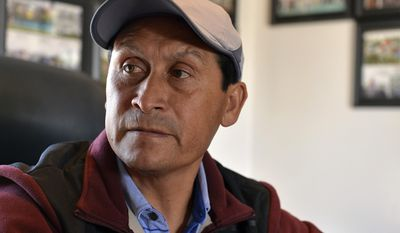 In this Thursday, April 13, 2017, photo, Baldemar Bahena, assistant trainer to Dale Romans, talks about the importance of immigrant workers to the horse racing industry in his backside office at Churchill Downs, in Louisville, Ky. (AP Photo/Timothy D. Easley)