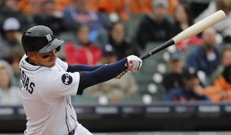 Detroit Tigers' Jose Iglesias hits a two-run double against the Chicago White Sox in the fifth inning of a baseball game in Detroit, Sunday, April 30, 2017. (AP Photo/Paul Sancya)