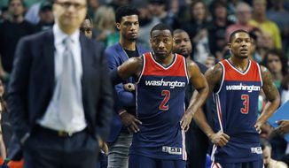 Wizards coach Scott Brooks, left, needs to find bench help for John Wall and Bradley Beal. (AP Photo/Michael Dwyer)
