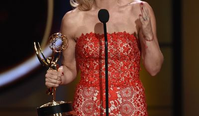 """Gina Tognoni accepts the award for outstanding lead actress in a drama series for """"The Young and the Restless"""" at the 44th annual Daytime Emmy Awards at the Pasadena Civic Center on Sunday, April 30, 2017, in Pasadena, Calif. (Photo by Chris Pizzello/Invision/AP)"""