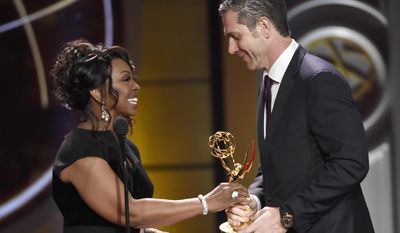 "Gladys Knight, left, presents Frank Valentini with the award for outstanding drama series for ""General Hospital"" at the 44th annual Daytime Emmy Awards at the Pasadena Civic Center on Sunday, April 30, 2017, in Pasadena, Calif. (Photo by Chris Pizzello/Invision/AP)"
