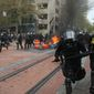 Some May Day rallies across the U.S. turned violent. Police were called in to disperse a crowd in downtown Portland, Oregon, Monday after authorities said the protesters had not obtained the proper permits. Marchers then began throwing projectiles at officers, and fires were soon blazing. (Associated Press photographs)