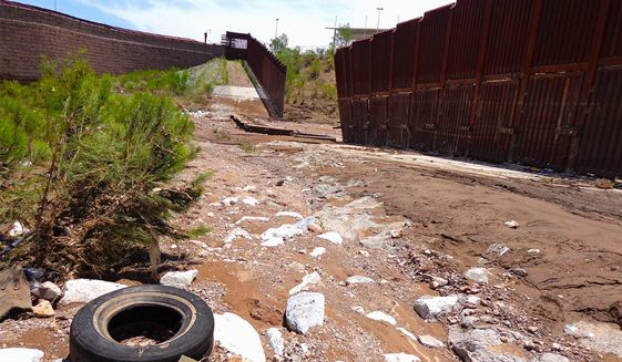 A section of the Southwestern U.S. border barrier lies collapsed following severe weather near Nogales, Arizona. (Associated Press)