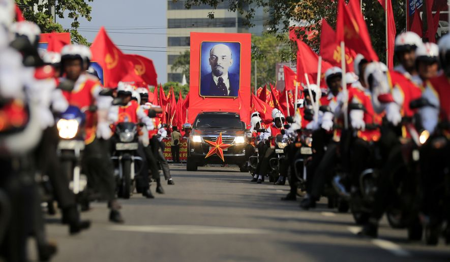 Members of the People's Liberation Front, a Marxist political party, carry a portrait of Russian Communist leader Vladimir Lenin during a parade held to mark May Day in Colombo, Sri Lanka, Monday, May 1, 2017. (AP Photo/Eranga Jayawardena)