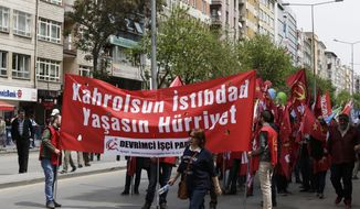 Protesters hold banners during a May day protest in Ankara, Turkey , Monday, May 1, 2017. Workers and activists marked May Day with defiant rallies and marches for better pay and working conditions Monday. (AP Photo/Burhan Ozbilici)