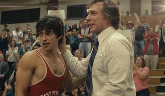 """A scene from """"American Wrestler: The Wizard.""""  (Variety)"""