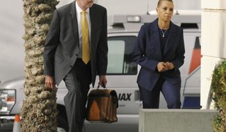 One Door president Carla Wiley, right, with her attorney Gray Thomas walk to the Federal Courthouse in Jacksonville, Fla., Monday, May 1, 2017, where she was scheduled to testify during the trial of former congresswoman Corrine Brown on federal fraud and tax charges . Wiley is the president of One Door charity which prosecutors say was used by former U.S. Rep. Corrine Brown as a personal slush fund. Wiley has already pleaded guilty to conspiracy to commit wire fraud. (Bob Self/The Florida Times-Union via AP)
