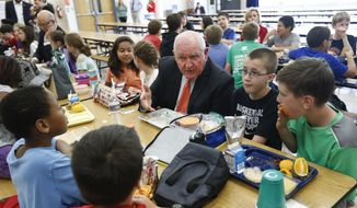 Agriculture Secretary Sonny Perdue has lunch with students in the cafeteria at Catoctin Elementary School in Leesburg, Va., Monday, May 1, 2017, after he unveiled a new rule on school lunches as the Trump administration and other Republicans press for flexibility after eight years of the Obama's emphasis on health eating. (AP Photo/Carolyn Kaster)