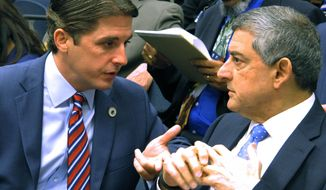House Appropriations Chairman Cameron Henry, R-Metairie, left, speaks to Commissioner of Administration Jay Dardenne, the governor's chief budget adviser, ahead of the committee's changes to the governor's spending proposal for next year, on Monday, May 1, 2017, in Baton Rouge, La. (AP Photo/Melinda Deslatte)