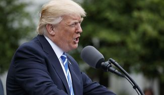 President Donald Trump speaks in the Kennedy Garden of the White House in Washington, Monday, May 1, 2017, to the Independent Community Bankers Association. (AP Photo/Evan Vucci)