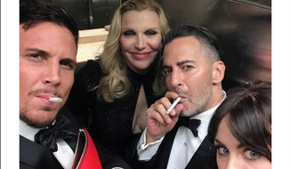 Tweet by designer Marc Jacobs, showing him smoking in a bathroom during the May 1 Met Gala in New York City along with musician Courtney Love, her daughter Frances Bean Cobain and model Char Defrancesco.