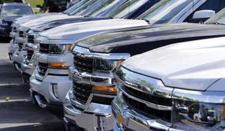 In this Wednesday, April 26, 2017, photo, Chevrolet trucks are lined up at a Chevrolet dealership in Richmond, Va. Analysts expect the auto industry to post a fourth straight month of lower sales as the pace of sales cools after last year's record. (AP Photo/Steve Helber)