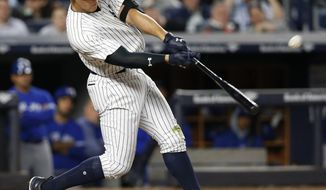 New York Yankees' Aaron Judge hits a three-run home run off Toronto Blue Jays relief pitcher Jason Grilli during the seventh inning of a baseball game in New York, Tuesday, May 2, 2017. It was Judge's second home run in the game. (AP Photo/Kathy Willens)