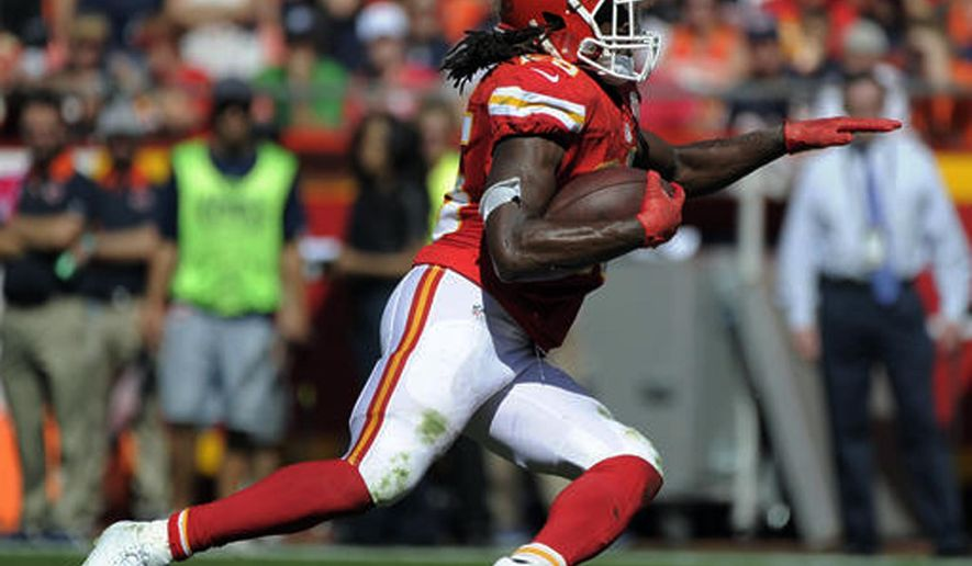 Elway Dealers >> FILE- In this Oct. 11, 2015, file photo, Kansas City Chiefs running back Jamaal Charles carries ...