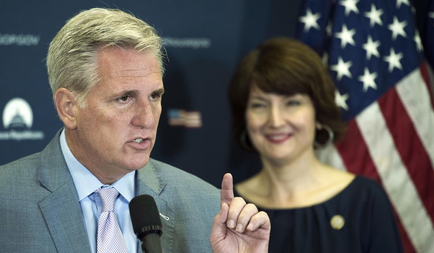 House Majority Leader Kevin McCarthy of Calif., accompanied by Rep. Cathy McMorris Rodgers, R-Wash., speaks with reporters on Capitol Hill in Washington, Tuesday, May 2, 2017, following the Republican Caucus meeting. (AP Photo/Cliff Owen)