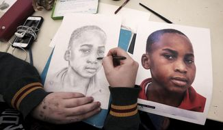 ADVANCE FOR MONDAY, MAY 8, 2017 -  In this Thursday, March 23, 2017 photo, Middleton High School sophomore Megan Graham works on a portrait of a young boy from the Democratic Republic of the Congo as part of The Memory Project in Middleton, Wis. (John Hart/Wisconsin State Journal via AP)