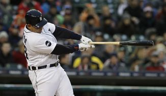 Detroit Tigers' Miguel Cabrera swings on a two-run home run during the third inning of the team's baseball game against the Cleveland Indians, Tuesday, May 2, 2017, in Detroit. (AP Photo/Carlos Osorio)