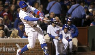 Chicago Cubs' Javier Baez hits a two-run triple off Philadelphia Phillies relief pitcher Mark Leiter Jr., scoring Addison Russell and Willson Contreras, during the fifth inning of a baseball game, Tuesday, May 2, 2017, in Chicago. (AP Photo/Charles Rex Arbogast)