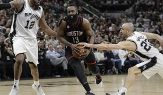 Houston Rockets guard James Harden (13) drives between San Antonio Spurs forward LaMarcus Aldridge (12) and guard Manu Ginobili (20) during the first half of Game 1 of a second-round NBA playoff series basketball game, Monday, May 1, 2017, in San Antonio. (AP Photo/Eric Gay)