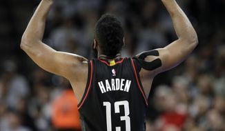Houston Rockets guard James Harden (13) reacts after he scores against the San Antonio Spurs during the first half in a second-round NBA playoff series basketball game, Monday, May 1, 2017, in San Antonio. (AP Photo/Eric Gay)