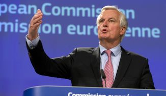 European Union chief Brexit negotiator Michel Barnier speaks during a media conference at EU headquarters in Brussels on Wednesday, May 3, 2017.  Barnier spoke to the media in Brussels on Wednesday regarding Britain's departure from the bloc and presented his draft mandate laying out the terms for the talks. (AP Photo/Virginia Mayo)