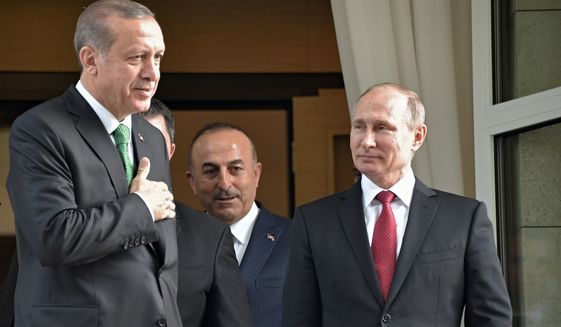 Turkish President Recep Tayyip Erdogan, left, says goodbye to Russian President Vladimir Putin, right, after their meeting in Putin's residence in the Russian Black Sea resort of Sochi, Russia, Wednesday, May 3, 2017. The presidents of Russia and Turkey held talks on the situation in Syria and also the restoration of full economic ties between their two countries. (Alexei Nikolsky/Sputnik, Kremlin Pool Photo via AP)