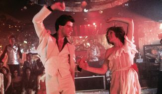 "Donna Pescow and John Travolta in a scene from ""Saturday Night Fever."""