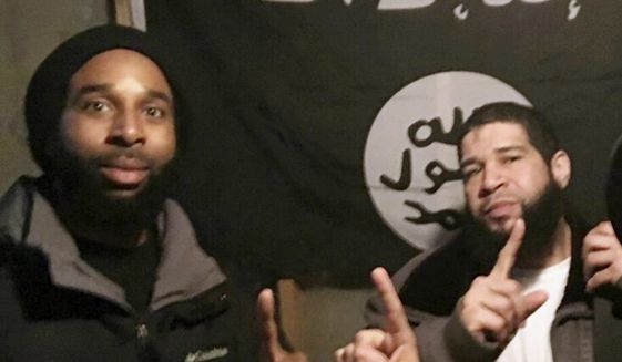 FILE - In this undated file photo provided by the FBI shows Joseph D. Jones, left, and Edward Schimenti, both of suburban Chicago, pose in front of an Islamic State group flag. The two men, who are accused of seeking to provide material support to terrorists, pleaded not guilty Wednesday, May 3, 2017, at federal court in Chicago. Both were arrested by FBI agents on April 12, 2017. (FBI via AP, File)