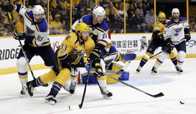 Nashville Predators left wing Colin Wilson (33) is defended by St. Louis Blues' Patrik Berglund (21), of Sweden, and Jay Bouwmeester (19) during the second period in Game 4 of a second-round NHL hockey playoff series, Tuesday, May 2, 2017, in Nashville, Tenn. (AP Photo/Mark Humphrey)