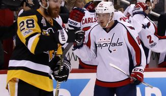 Washington Capitals' Nate Schmidt (88) celebrates his goal as he returns to the bench during the second period of Game 4 in an NHL Stanley Cup Eastern Conference semifinal hockey game against the Pittsburgh Penguins in Pittsburgh, Wednesday, May 3, 2017. (AP Photo/Gene J. Puskar)