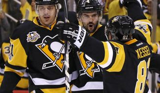 Pittsburgh Penguins' Justin Schultz (4) celebrates his goal with Evgeni Malkin (71) and Phil Kessel (81) during the second period of Game 4 in an NHL Stanley Cup Eastern Conference semifinal hockey game against the Washington Capitals in Pittsburgh, Wednesday, May 3, 2017. (AP Photo/Gene J. Puskar)