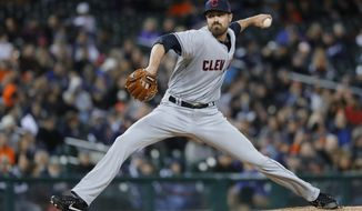 Cleveland Indians relief pitcher Andrew Miller throws to a Detroit Tigers batter during the seventh inning of a baseball game in Detroit, Wednesday, May 3, 2017. (AP Photo/Paul Sancya)