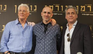 """American actor Richard Gere, left, movie director Joseph Cedar, center, and Israeli actor Lior Ashkenazi, stand for a photo before a press at then premiere of the """"Norman: The Moderate Rise and Tragic Fall of a New York Fixer,"""" movie in Jerusalem, Thursday, March 9, 2017. (AP Photo/Dan Balilty)"""