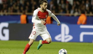 Monaco's Bernardo Silva goes for the ball during the Champions League semifinal first leg soccer match between Monaco and Juventus at the Louis II stadium in Monaco, Wednesday, May 3, 2017. (AP Photo/Claude Paris)