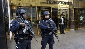 FILE - In this Nov. 11, 2016, file photo, New York City Police officers guard the front of Trump Tower, in New York. President Donald Trump is coming home. The born-and-bred New Yorker, whose image for decades was interwoven with his brash hometown, is making his first trip back to Manhattan since taking office, returning to New York City on Thursday, May 4, to mark the anniversary of an important World War II battle by making a speech on a decommissioned aircraft carrier docked on the Hudson River. (AP Photo/Richard Drew, File)