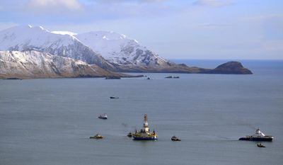 FILE - This Jan. 7, 2013, file photo, shows the Shell floating drill rig Kulluk in Kodiak Island, Alaska's Kiliuda Bay as salvage teams conduct an in-depth assessment of its seaworthiness after it ran aground off an island near Kodiak as it was being towed across the Gulf of Alaska in stormy weather following the 2012 drilling season. Less than a week after President Donald Trump took steps to put U.S. Arctic and Atlantic waters back in play for offshore drilling, 10 environmental and Alaska Native groups sued Wednesday, May 3, 2017, to maintain the ban on oil and gas exploration.  (James Brooks/Kodiak Daily Mirror via AP, File)