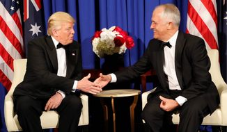 President Trump meets with Australian Prime Minister Malcolm Turnbull aboard the USS Intrepid, a decommissioned aircraft carrier, on the Hudson River on Thursday. (Associated Press)